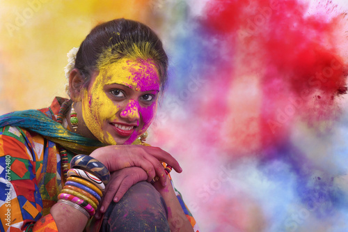 Foto Murales Portrait of  young Indian Woman celebrating Holi color festival