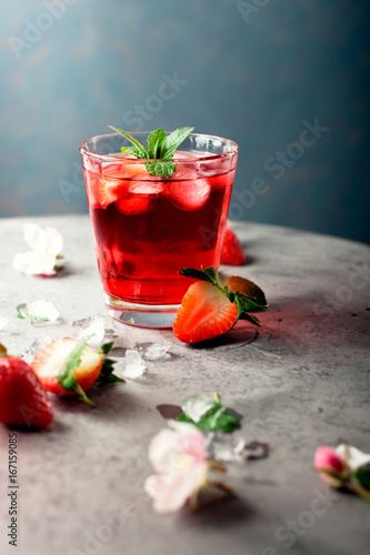 Fresh strawberry and mint drink/cocktail on grey background