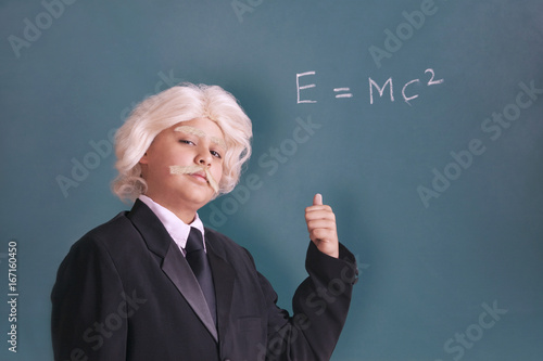 Portrait of boy dressed as Einstein with maths equation Poster