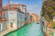 VENICE, ITALY - MAY 12, 2017 : Views of the most beautiful channels of Venice, narrow streets, houses.