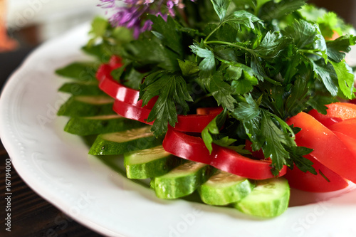 Fresh salad of tomatoes, cucumbers, peppers, arugula and dill jpg