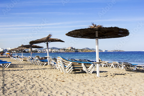 Chairs and umbrellas on a beautiful sandy beach at Ibiza