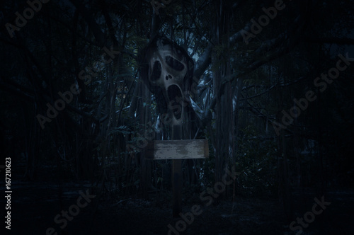Cross with ghost scream over spooky forest at night time, Horror background, Hal Poster