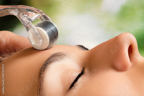 Beauty treatment with skin derma roller.