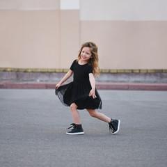little girl dancing on the street