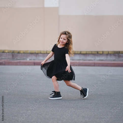 little girl dancing on the street