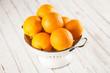 Quadro Fresh oranges in a colander