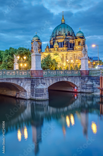 The Schlossbruecke and the cathedral in Berlin at dusk Poster