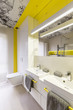 Quadro Neon yellow bathroom design idea