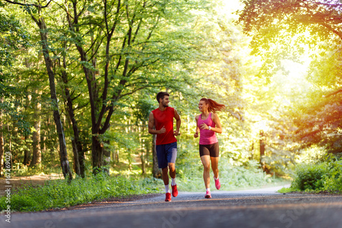 Young couple running in nature.