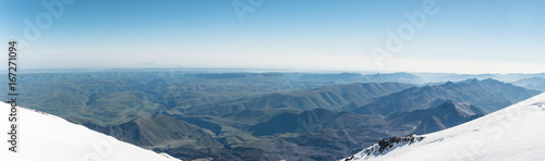 Foto op Canvas Blauw Panorama View of the summer northern caucasus from the snow-capped summit of Elbrus