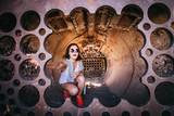 Girl inside the sculpture