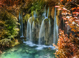 Waterfall in autumn forest at National Park Plitvice Lakes.