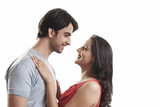 Side view of loving couple looking at each other against white background - 167298219