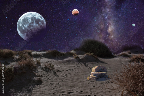 An unrealistic night landscape with milky, moon in eclipse, and desert with ruins of ancient columns.