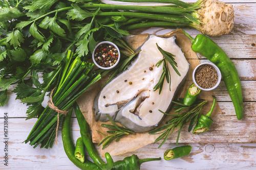 Raw fresh white fish steak with vegetables ingredients