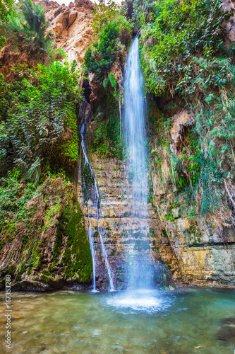 Falls Shulamit and pond with emerald water