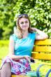 Beautiful teenage girl sitting on the bench