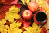 Autumn mood. Autumn tea drinking. Autumn maple leaves, tea, apples and a warm blanket