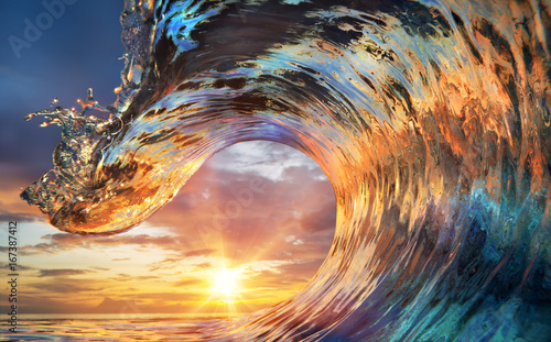 Colorful Ocean Wave. Sea water in crest shape. Sunset light and beautiful clouds on background