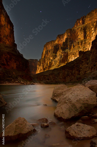 The Colorado River is blurred by the long exposure of the Grand Canyon by moonlight, Tuckup Canyon, Grand Canyon National Park, AZ, USA.