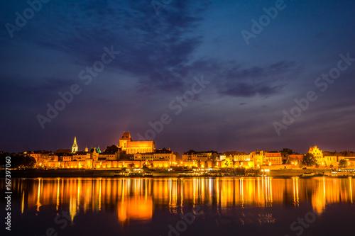 Fototapeta Night view of Torun city and Vistula river, Poland