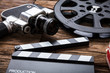 Movie Camera With Film Reel And Clapper Board On Wood - 167402253