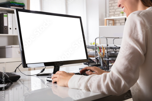 Wall mural Businesswoman Working On Computer