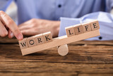 Person Showing Misbalance Between Work And Life