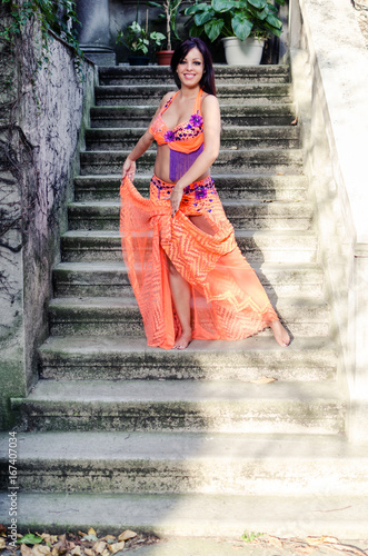 Dancing belly dance on stairs Poster