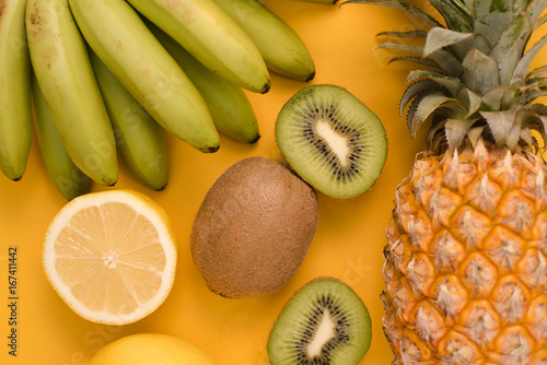 Set of fruits on a yellow background - 167411442
