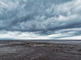 Stormy clouds and filthy sea