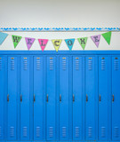 Lockers and a cheerful banner to welcome students back to school - 167420090
