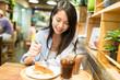 Woman having cake in coffee shop