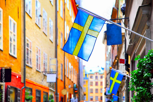 Poster Stockholm Street in Stockholm with swedish flags