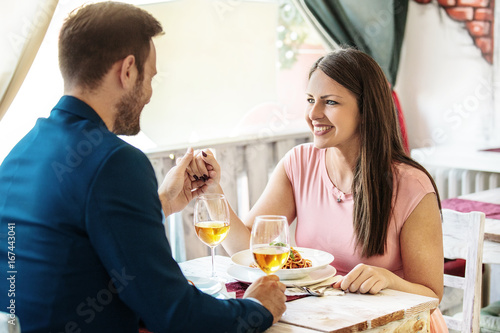 Happy Couple in a Restaurant - 167443041