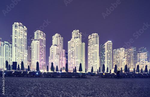 Fotobehang Dubai Vintage toned picture of Dubai beach district at night, UAE.