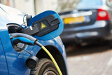 power supply plugged into an electric car during charging