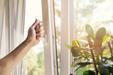 hand open white plastic pvc window at home - 167486483