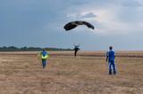 Parachutist running after landing in a field
