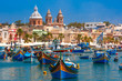 Leinwanddruck Bild - Traditional eyed colorful boats Luzzu in the Harbor of Mediterranean fishing village Marsaxlokk, Malta