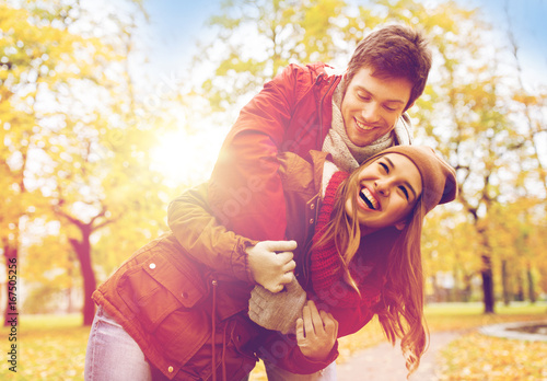 happy young couple hugging in autumn park - 167505256