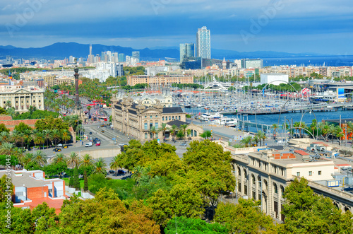Aerial view of Barcelona. Passeig de Colom avenue and Columbus monument, La Barceloneta and Port Vell. Catalonia, Spain