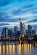 Vertical image of illuminated Frankfurt skyline at night