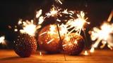 celebration / three burning  sparklers and glitter balls /  - 167518602