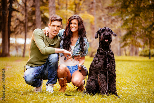 Smiling Couple With A Dog