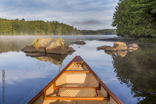 Papiers peints Canada Bow of canoe on a lake in early morning - Ontario, Canada