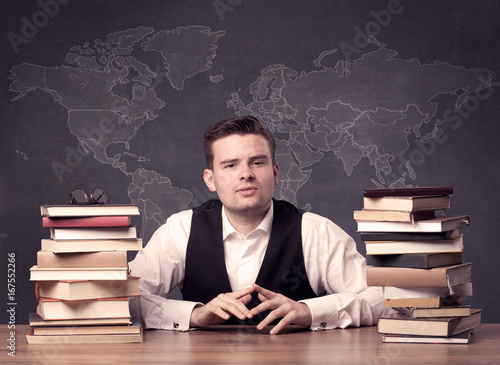 Geography teacher at desk