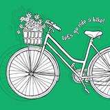 Rower z kwiatami na zielonym tle