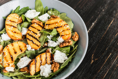 Salad of peaches grilled, ricotta and arugula. Healthy food